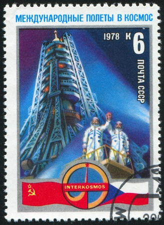 RUSSIA - CIRCA 1978: stamp printed by Russia, shows Rocket, Soviet Cosmonaut Aleksei Gubarev and Czechoslovak Capt. Vladimir Remek on launching pad, circa 1978 photo