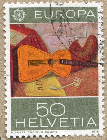SWITZERLAND - CIRCA 1975: stamp printed by Switzerland, shows Still Life with Guitar, by Rene Auberjonois, circa 1975. photo