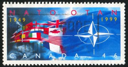 nato: CANADA - CIRCA 1999: stamp printed by Canada, shows NATO, 50th Anniv., circa 1999 Editorial