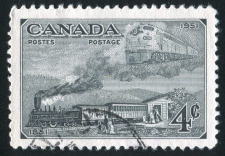 CANADA - CIRCA 1951: stamp printed by Canada, shows Trains of 1851 and 1951, circa 1951 Stock Photo - 9981252