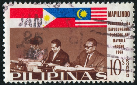 sukarno: PHILIPPINES - CIRCA 1965: stamp printed by Philippines, shows Presidents Sukarno and Macapagal and Prime Minister Tunku Abdul Rahman, circa 1965