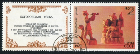 RUSSIA - CIRCA 1979: stamp printed by Russia, shows Horn Player and Bears Playing Balalaika, Bogorodsk Wood Carvings, circa 1979 photo