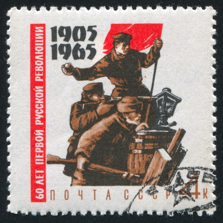 RUSSIA - CIRCA 1965: stamp printed by Russia, shows Fighters on barricades with red flag, circa 1965 Stock Photo - 9981031