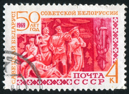 RUSSIA - CIRCA 1969: stamp printed by Russia, shows Partisans and sword, circa 1969 Stock Photo - 9981090