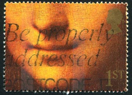 mona lisa: GREAT BRITAIN - CIRCA 1990: stamp printed by Great Britain, shows Mona Lisa or La Gioconda Louvre, Paris, France, circa 1990