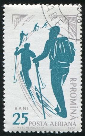 ROMANIA - CIRCA 1961: stamp printed by Romania, show skier, circa 1961. photo