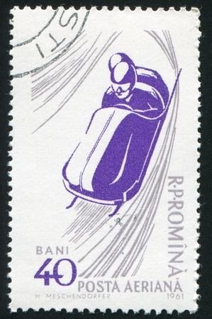 bobsled: ROMANIA - CIRCA 1961: stamp printed by Romania, show bobsled, circa 1961.