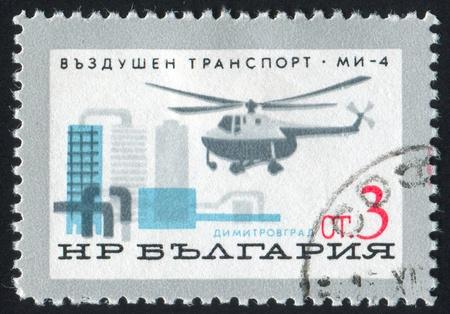 BULGARIA - CIRCA 1965: stamp printed by Bulgaria, shows Mi-4 Helicopter over Dimitrovgrad, circa 1965 photo