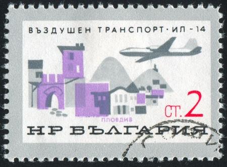 window seal: BULGARIA - CIRCA 1965: stamp printed by Bulgaria, shows IL-14 over Plovdiv, circa 1965