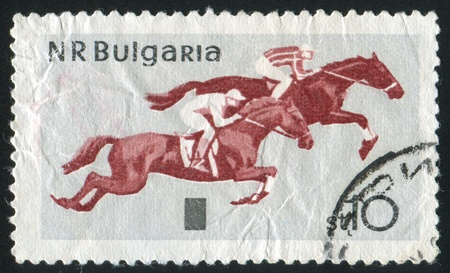 jackboots: BULGARIA - CIRCA 1965: stamp printed by Bulgaria, shows Horsemanship, Steeplechase, circa 1965 Stock Photo
