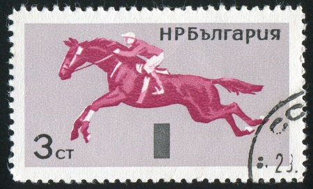 jackboots: BULGARIA - CIRCA 1965: stamp printed by Bulgaria, shows Horsemanship, Jumping, circa 1965 Stock Photo