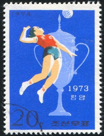 KOREA DPR - CIRCA 1974: stamp printed by Korea DPR, shows N. Korean Victories at Sports Contests, Volleyball (Pyongyang), circa 1974 photo