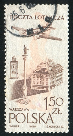 POLAND - CIRCA 1957: stamp printed by Poland, shows Plane over Castle Square, Warsaw, circa 1957 photo