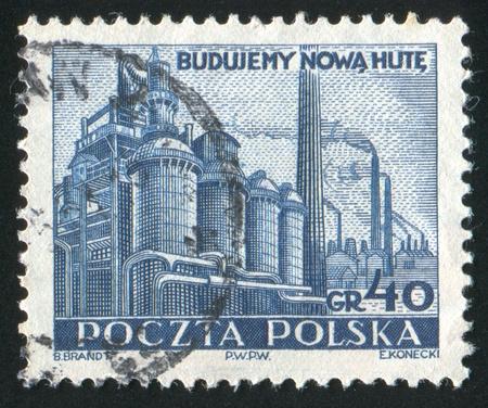 POLAND - CIRCA 1951: stamp printed by Poland, shows Steel Mill, Nowa Huta, circa 1951 photo