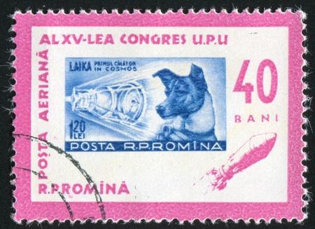 upu: ROMANIA - CIRCA 1963: stamp printed by Romania, shows Centenary Stamp of 1958, Sputnic 2 and Laika, circa 1963 Stock Photo