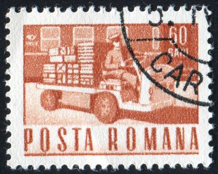 ROMANIA - CIRCA 1968: stamp printed by Romania, shows Small loading truck, circa 1968 photo
