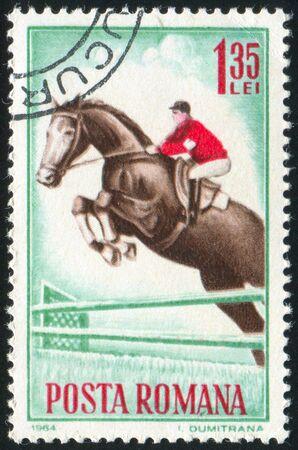 jackboots: ROMANIA - CIRCA 1964: stamp printed by Romania, shows Jumping, circa 1964 Stock Photo