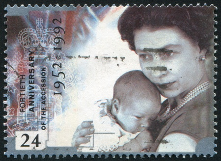 accession: GREAT BRITAIN - CIRCA 1992: stamp printed by Great Britain, shows Queen Elizabeth II Accession to the Throne, Holding infant Prince Andrew, circa 1992 Editorial