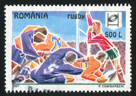ROMANIA - CIRCA 1997: stamp printed by Romania, show rugby, circa 1997. photo