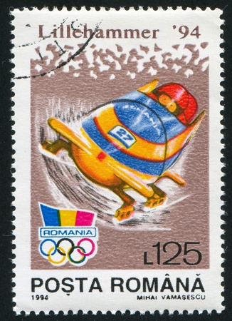 bobsled: ROMANIA - CIRCA 1994: stamp printed by Romania, show bobsled, circa 1994.