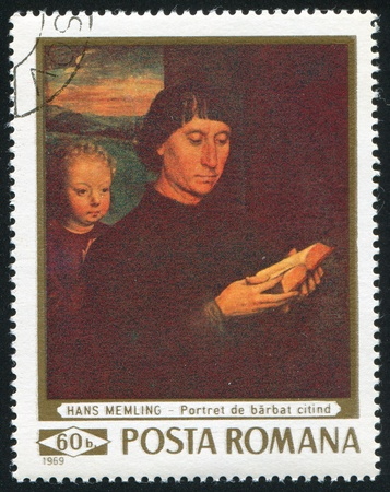 ROMANIA - CIRCA 1969: stamp printed by Romania, shows picture of reading man by Hans Memling(1430 - 1494), circa 1969