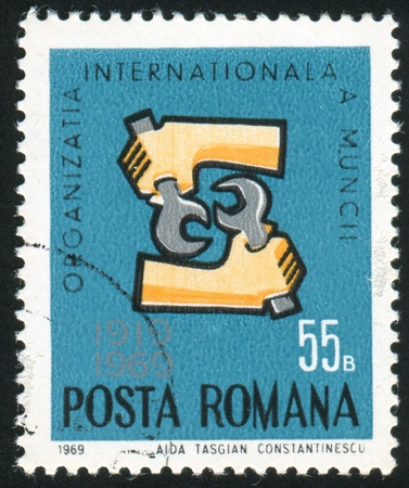 signifier: ROMANIA - CIRCA 1969: stamp printed by Romania, shows emblem of international labour organization, circa 1969