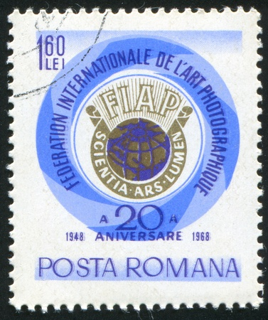 signifier: ROMANIA - CIRCA 1968: stamp printed by Romania, shows emblem of International federation of photographing art, circa 1968 Stock Photo
