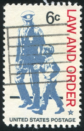 UNITED STATES - CIRCA 1968: stamp printed by United States, shows The police as protector and friend and respect for law and order, circa 1968 Stock Photo - 10373869