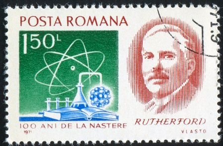 ernest: ROMANIA - CIRCA 1971: stamp printed by Romania, shows Baron Ernest R. Rutherford, atom, nucleus and chemical apparatus (1871-1937), circa 1971