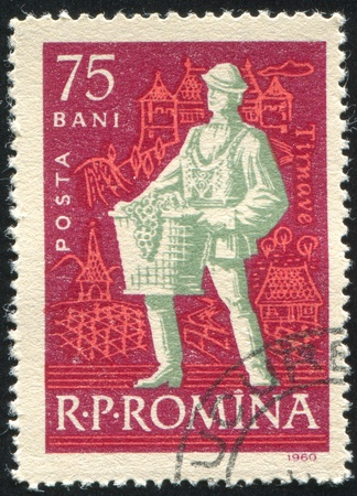 jackboots: ROMANIA - CIRCA 1960: stamp printed by Romania, shows Wine peasant, Vintner with basket, circa 1960