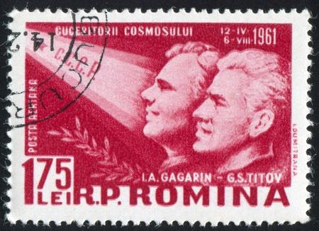 gagarin: ROMANIA - CIRCA 1961: stamp printed by Romania, shows Yuri A. Gagarin and Gherman S. Titov, circa 1961