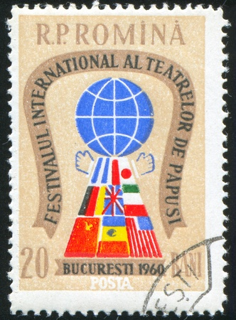 international puppet festival: ROMANIA - CIRCA 1960: stamp printed by Romania, shows International Puppet Theater Festival Emblem, circa 1960