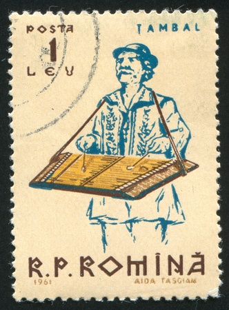 ROMANIA - CIRCA 1961: stamp printed by Romania, shows Peasants playing musical instruments, Zither, circa 1961 photo