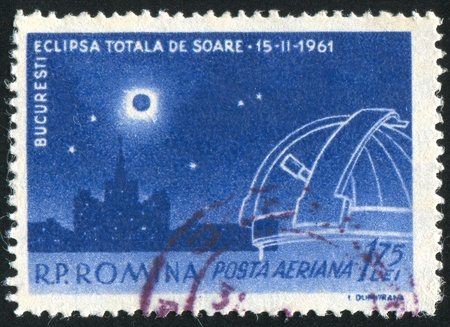 ROMANIA - CIRCA 1961: stamp printed by Romania, shows Total Eclipse, Scinteia House, telescope, circa 1961 Stock Photo - 10432747
