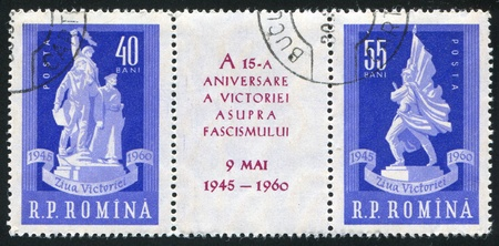 ROMANIA - CIRCA 1960: stamp printed by Romania, shows 15th anniversary of the liberation, Heroes Monument, Soviet war memorial, circa 1960 Stock Photo - 10432828