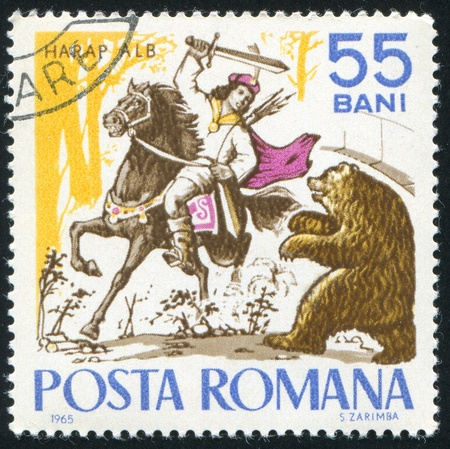 ROMANIA - CIRCA 1965: stamp printed by Romania, shows Fairy Tales, Harap Alb and the Bear, circa 1965 Stok Fotoğraf - 10432817