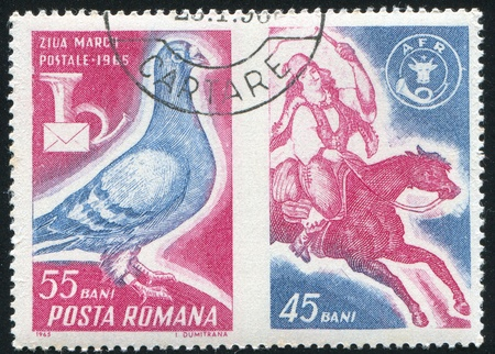 jackboots: ROMANIA - CIRCA 1965: stamp printed by Romania, shows Pigeon and Post Horn, Post Rider, circa 1965 Stock Photo