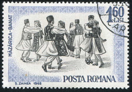ROMANIA - CIRCA 1966: stamp printed by Romania, shows Folk Dancers of Moldavia, Banat, circa 1966 Stock Photo - 10432822
