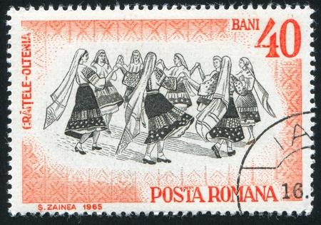 ROMANIA - CIRCA 1966: stamp printed by Romania, shows Folk Dancers of Moldavia, Oltenia, circa 1966 Stock Photo - 10432640