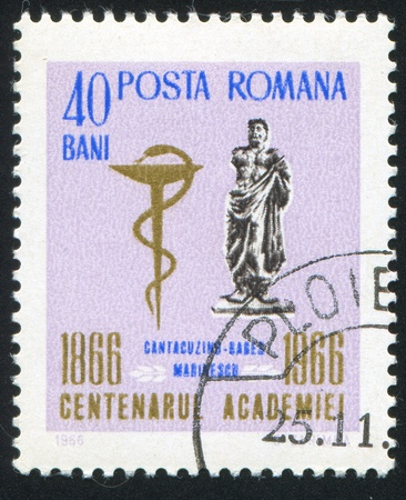 medical school: ROMANIA - CIRCA 1966: stamp printed by Romania, shows Statue of Ovid and Medical School Emblem, circa 1966