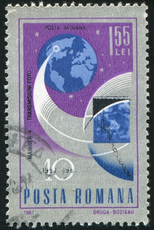 transmitting: ROMANIA - CIRCA 1967: stamp printed by Romania, shows Mariner 4 transmitting pictures of the moon, circa 1967