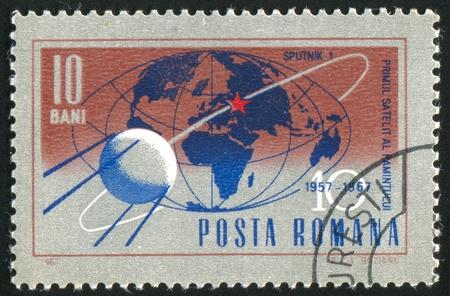 ROMANIA - CIRCA 1967: stamp printed by Romania, shows Trajectory of Sputnik 1 around globe, circa 1967 photo