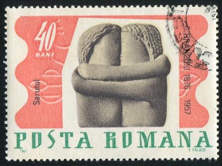 ROMANIA - CIRCA 1967: stamp printed by Romania, shows The Kiss, by Brancusi, circa 1967 photo