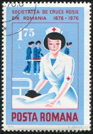 nurse cap: ROMANIA - CIRCA 1976: stamp printed by Romania, shows Nurse with patient, circa 1976