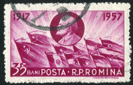 ROMANIA - CIRCA 1957: stamp printed by Romania, shows Lenin and  Flags, circa 1957 Stock Photo - 10634560