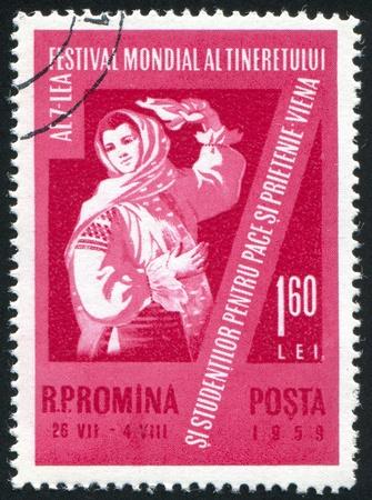 ROMANIA - CIRCA 1959: stamp printed by Romania, shows Dancer in folk costume, circa 1959 Stock Photo - 10634663