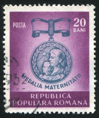 ROMANIA - CIRCA 1952: stamp printed by Romania, shows Medal for Motherhood, circa 1952 Stock Photo - 10634456