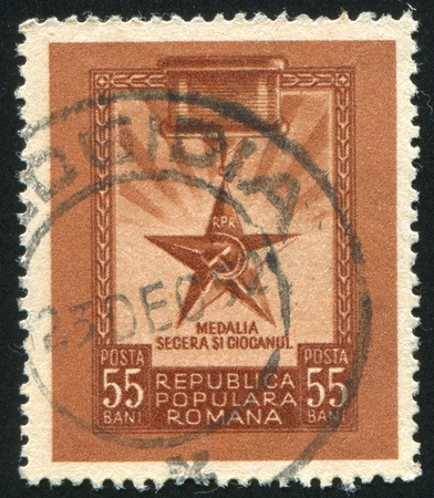 ROMANIA - CIRCA 1952: stamp printed by Romania, shows Hammer and sickle medal, circa 1952 Stock Photo - 10634222