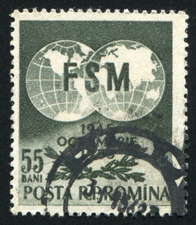 ROMANIA - CIRCA 1955: stamp printed by Romania, shows Globes and Olive Branches, circa 1955 photo