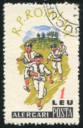 ROMANIA - CIRCA 1960: stamp printed by Romania, shows Children Sports, Running, circa 1960 photo